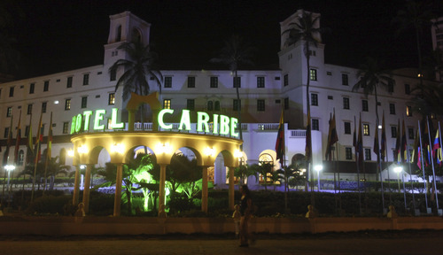 FILE - In this April 19, 2012, file photo, people walk past Hotel El Caribe in Cartagena, Colombia. Washington politicians are doing a delicate dance around the Secret Service prostitution scandal. People are loath to criticize agents trained to take a bullet for the president. And illicit sex isn't a topic some members of Congress want to discuss in an election year. Or any year. So all sides are calling for thorough investigations by the Secret Service. Six agents have been fired after allegations that a dozen of them, and as many military enlistees, paid for sex in Colombia. (AP Photo/Pedro Mendoza, File)