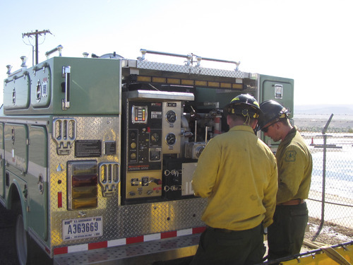 Mark Havnes     The Salt Lake Tribune Fireengine student and firefighter Erik Danko gets instruction in fireengine pumping equipment from firefighter Cody Mcfarland Tuesday during training at Great Basin Fire Academy being held in St. George.