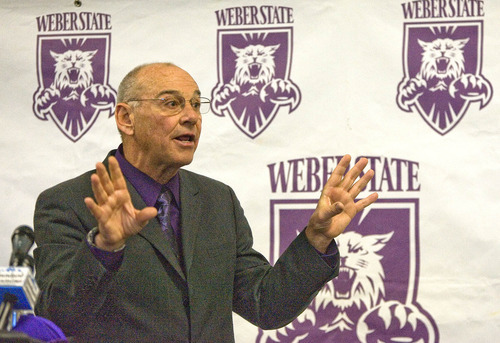 Paul Fraughton | The Salt Lake Tribune John L. Smith talks to Weber State supporters and members of the press at his introduction as Weber State's new head football coach.   Tuesday, December 6, 2011