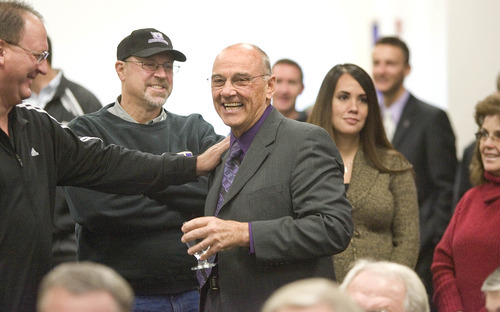Paul Fraughton | The Salt Lake Tribune New Weber State head coach John L. Smith is greeted by supporters  before being introduced at a press conference.   Tuesday, December 6, 2011