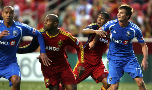 Steve Griffin/The Salt Lake Tribune   RSL's Jamison Olave and Chris Schuler battle the Montreal defense during a game at Rio Tinto Stadium in Sandy on Wednesday, April 4, 2012.
