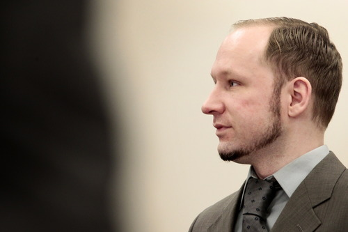 Anders Behring Breivik stands in the courtroom in Oslo Wednesday, April 25, 2012. After testifying for five days, Anders Behring Breivik listened silently Tuesday as others described the mayhem caused by his bombing of Oslo's government district, a scene one witness described as a