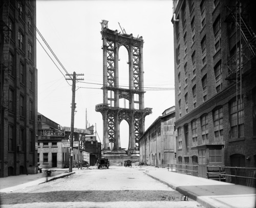 In this June 5, 1908 photo provided by the New York City Municipal Archives, the superstructure from the Manhattan Bridge rises above Washington Street in New York. Over 870,000 photos from an archive that exceeds 2.2 million images have been scanned and made available online, for the first time giving a global audience a view of a rich collection that documents life in New York City.  (AP Photo/New York City Municipal Archives, Department of Bridges/Plant & Structures, Eugene de Salignac)