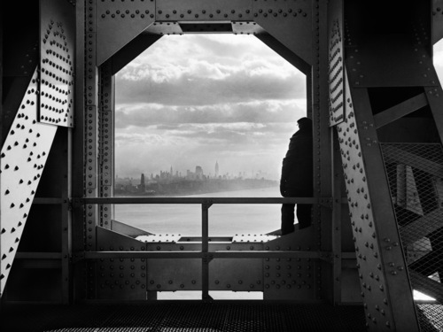 In this Dec. 22, 1936, Works Progress Administration photo provided by the New York City Municipal Archives, a man looks at the Hudson River from the New York tower of the George Washington Bridge. Over 870,000 photos from an archive that exceeds 2.2 million images have been scanned and made available online, for the first time giving a global audience a view of a rich collection that documents New York City life.  (AP Photo/New York City Municipal Archives, WPA Federal Writers' Project, Jack Rosenzwieg)