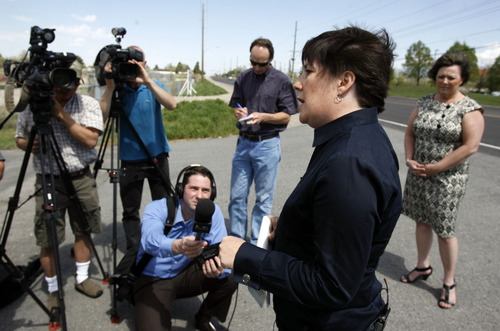 Francisco Kjolseth  |  The Salt Lake Tribune Maryann Martindale, of the Alliance for a Better Utah, speaks about the case concerning Denice Graham, at right, the Utah Department of Transportation (UDOT) employee who was reinstated after her wrongful termination in the wake of an Interstate 15 contracting scandal, as she gets ready to speak to the media on Tuesday, April 24, 2012.