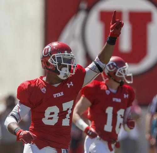 Trent Nelson     The Salt Lake Tribune Receiver Quinton Pedroza celebrates his fourth quarter touchdown at the Utah Red and White football game Saturday, April 21, 2012 in Salt Lake City, Utah.