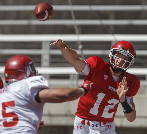 Trent Nelson  |  The Salt Lake Tribune Quarterback Adam Schulz passes the ball at the Utah Red and White football game Saturday, April 21, 2012 in Salt Lake City, Utah.