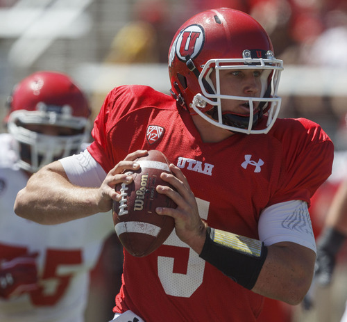 Trent Nelson  |  The Salt Lake Tribune Quarterback Chase Hansen scrambles at the Utah Red and White football game Saturday, April 21, 2012 in Salt Lake City, Utah.