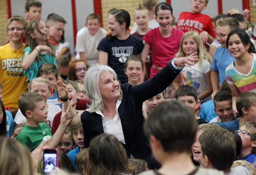 Al Hartmann  |  The Salt Lake Tribune Bountiful's Oak Hills Elementary principal Julie Larsen gets a big group congraultaions from her students in a surprise school assembly where she was awarded a Huntsman award for $10,000.