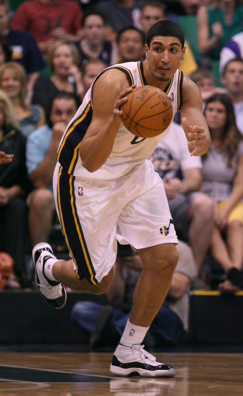 Steve Griffin/The Salt Lake Tribune   Utah's Enes Kanter dribbles up court during a game at EnergySolutions Arena in Salt Lake City, on Tuesday, April 24, 2012.