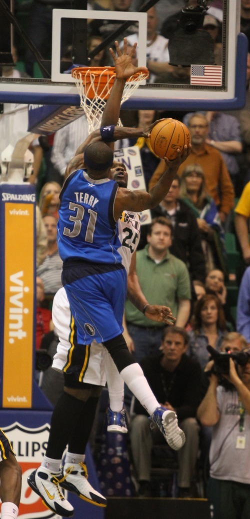 Rick Egan  | The Salt Lake Tribune   Dallas Mavericks shooting guard Jason Terry (31) talks the ball to the hoop, as Utah Jazz center Al Jefferson (25) defends, in NBA action, The Utah Jazz, vs. Dallas Mavericks, at the EnergySolutions Arena, Monday, April 16, 2012.