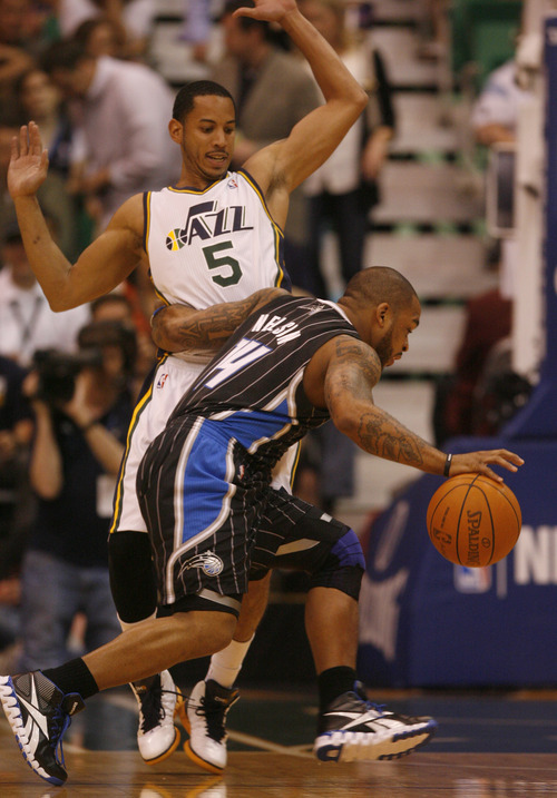 Rick Egan  | The Salt Lake Tribune   Utah Jazz point guard Devin Harris (5) defends as Orlando Magic point guard Jameer Nelson (14) drives inside, Jazz vs. The Orlando Magic, in Salt Lake City,  Saturday, April 21, 2012