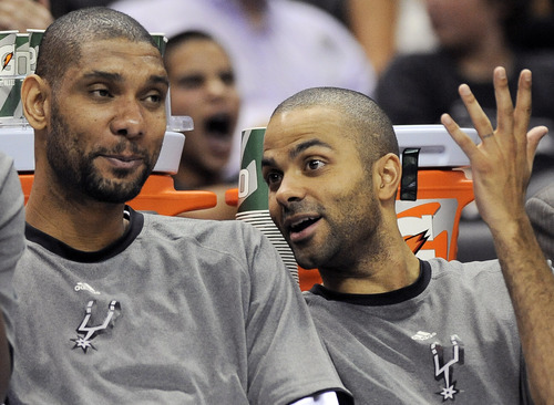 San Antonio Spurs' Tim Duncan, left, and Tony Parker, of France, talk during the second half of an NBA basketball game against the Cleveland Cavaliers, Sunday, April 22, 2012, in San Antonio. The Spurs won 114-98. (AP Photo/Darren Abate)