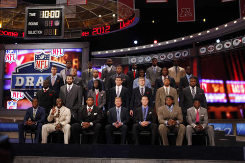 NFL football draft candidates pose for a group photo with NFL Commissioner Roger Goodell, center, before the start of the first round at Radio City Music Hall, Thursday, April 26, 2012, in New York. (AP Photo/Jason DeCrow)