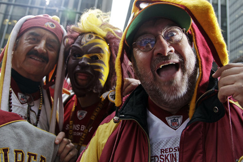 Washington Redskins fans wear team apparel on the red carpet for the NFL football draft at Radio City Music Hall, Thursday, April 26, 2012, in New York. (AP Photo/Mary Altaffer)