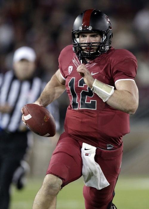 FOR USE AS DESIRED WITH NFL DRAFT STORIES - FILE - In this Nov. 26, 2011, file photo, Stanford quarterback Andrew Luck (12) runs with the ball during the second quarter of an NCAA college football game in Stanford, Calif. Luck is a top prospect in the upcoming NFL football draft. (AP Photo/Paul Sakuma, File)
