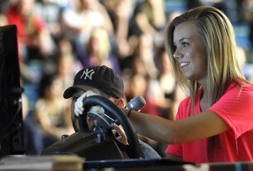 Rick Egan  | The Salt Lake Tribune   Copper HIlls student Lauren Sperry tries to text while driving a simulator, during the