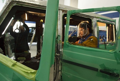 Leah Hogsten  |  The Salt Lake Tribune International Armoring Corporation's technicians Francisco Agredano and Carlos Estrada prepare a vehicle for armoring. The Centerville-based business makes vehicles for heads of state in foreign countries, celebrities and some of the wealthiest people in the world. Twenty percent to 30 percent of IAC's business is military.
