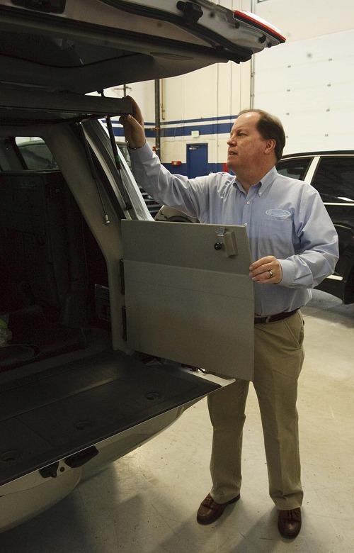 Leah Hogsten  |  The Salt Lake Tribune Mark Burton shows off a modified vehicle that costs $65,000 to $85,000, enhanced with two inch thick windows and reinforced walls  making them able to withstand attacks, but maintaining the appearance of an unaltered vehicle. Once a certified public accountant, International Armoring Corporation CEO and President Mark F. Burton, branched out into armoring cars in 1993. His Utah business based in Centerville, with installation facilities in S. Africa, the Philipines, UK, and Hong Kong, makes vehicles for heads of state in foreign countries, celebrities and some of the wealthiest people in the world.  Friday, April 13 2012 in Centerville.