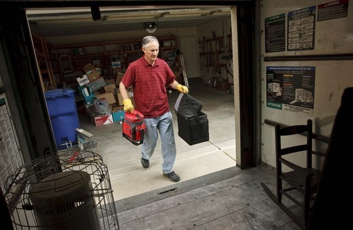 Leah Hogsten  |  The Salt Lake Tribune Taylorsville resident Randy Hulbert packs a small U-Haul trailer with he and his wife's belongings Thursday, April 26 2012 in Taylorsville. Hulbert's 3,500 sq.ft.home took 13 days to sell and is now under contract awaiting an appraisal.