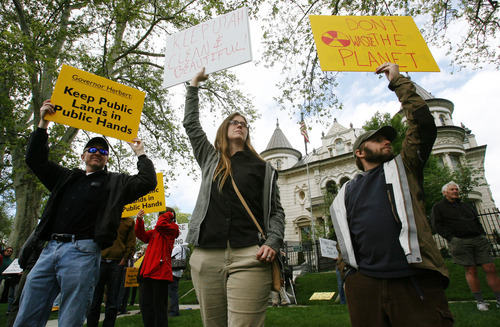 Steve Griffin/The Salt Lake Tribune Southern Utah Wilderness Alliance (SUWA) members protest at the Governor's Mansion in Salt Lake City, Utah. The envirormentalists say they are frustrated at Gov. Gary Herbert's