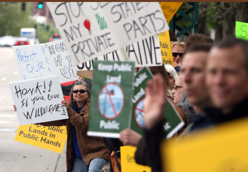 Steve Griffin/The Salt Lake Tribune Southern Utah Wilderness Alliance (SUWA) members demonstrated Friday outside the Governor's Mansion as chief executives from Utah, Wyoming, Idaho and New Mexico discussed public lands, energy and water issues.