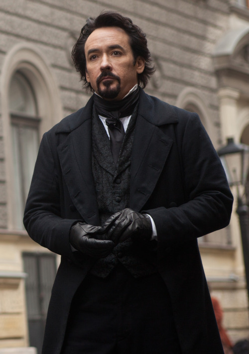In this film publicity image released by Relativity Media, John Cusack portrays Edgar Allan Poe in a scene from the gothic thriller