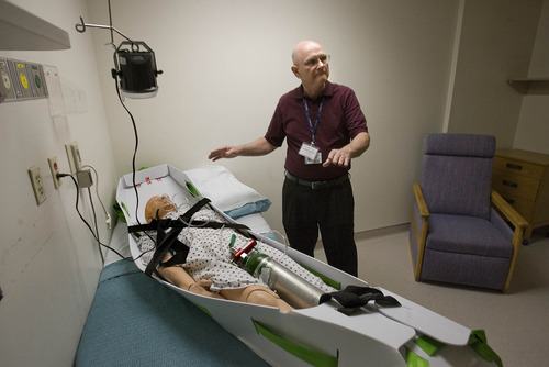 Paul Fraughton  |  The Salt Lake Tribune Ed Francis, emergency management coordinator for Intermountain Health Care, shows an evacuation sled and explains how it is used at an educational symposium Friday at Salt Lake City's LDS Hospital, which began operating its Intermountain Center for Disaster Preparedness in a wing of the building. The center offers training and patient simulation for public and private teams involved with emergency preparedness.