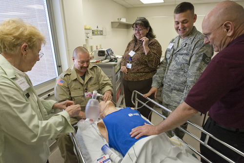 Paul Fraughton  |  The Salt Lake Tribune Dr. A. Elaine Bond and field paramedic Chuck Cruz demonstrate Friday how to intubate a patient using a demonstration mannequin. Donna Hall, Johnathan Kirkland, of the Utah National Guard, and Ed Francis watch. The event was an educational symposium at Salt Lake City's LDS Hospital, which began operating its Intermountain Center for Disaster Preparedness in a wing of the building. The center offers training and patient simulation for public and private teams involved with emergency preparedness.