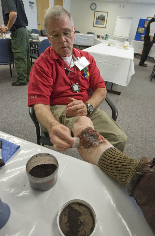 Paul Fraughton  |  The Salt Lake Tribune Bob Fowler of the Utah Department of Health gives himself a simulated third-degree burn on his leg. Fowler was demonstrating the art of