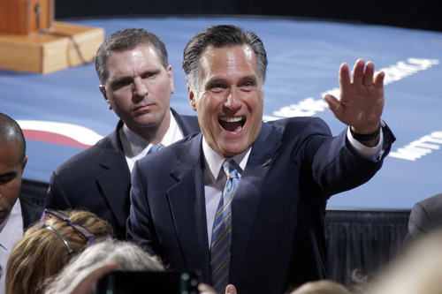 Republican presidential candidate, former Massachusetts Gov. Mitt Romney greets supporters at an election night rally in Manchester, N.H., Tuesday, April 24, 2012. (AP Photo/Jae C. Hong)