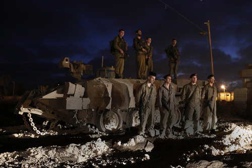 Israeli soldiers stand still as a siren marks the annual Memorial Day for fallen Israeli soldiers, near the Israel border with Gaza Strip,Tuesday, April 24, 2012.  (AP Photo / Tsafrir Abayov)