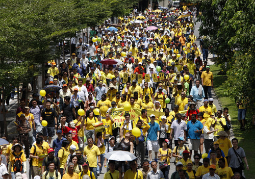 Protesters march on a street during a rally to demand for electoral reforms in Kuala Lumpur, Malaysia, Saturday, April 28, 2012. Thousands of people gathered near Kuala Lumpur's Independence Square to seek sweeping changes in polling regulations to curb fears of fraud in elections that many speculate will be held in June. (AP Photo/Lai Seng Sin)