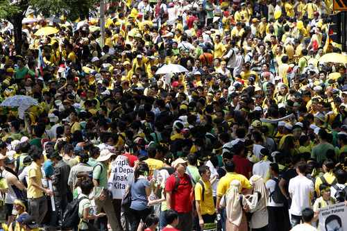 Protesters walk on a street during a rally to demand for electoral reforms in Kuala Lumpur, Malaysia, Saturday, April 28, 2012. Thousands of people gathered near Kuala Lumpur's Independence Square to seek sweeping changes in polling regulations to curb fears of fraud in elections that many speculate will be held in June. (AP Photo/Lai Seng Sin)