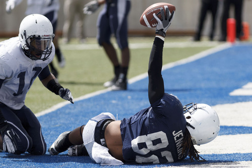 Trent Nelson  |  The Salt Lake Tribune Receiver Jordan Jenkins scores a touchdown at Utah State's annual Blue and White football game Saturday, April 28, 2012 in Logan, Utah.