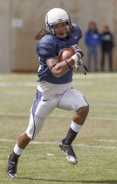 Trent Nelson  |  The Salt Lake Tribune Receiver Jordan Jenkins runs for yardage at Utah State's annual Blue and White football game Saturday, April 28, 2012 in Logan, Utah.