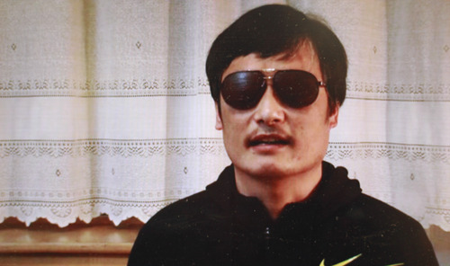 FILE- This file image made from video posted to YouTube April 27, 2012 by by overseas Chinese news site Boxun.com, shows blind legal activist Chen Guangcheng.  U.S. Assistant Secretary of State Kurt Campbell arrived early Sunday, April 29 in Beijing on a hastily arranged trip as problems from the escape of a blind legal activist to possible new arms sales to Taiwan threaten to derail fragile U.S.-China co-operation. His trip comes after activist Chen Guangcheng escaped from house arrest in his rural village (AP Photo/Boxun.com, File)