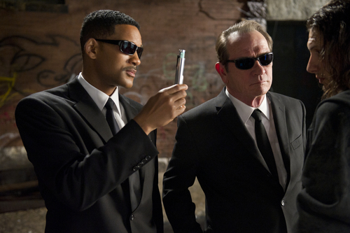 In this film image released by Sony, Will Smith, left, and Tommy Lee Jones are shown in a scene from