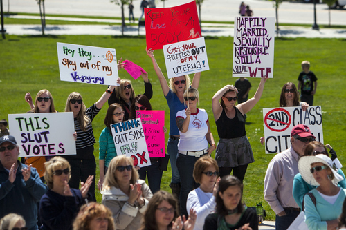 Chris Detrick  |  The Salt Lake Tribune Participants hold up signs during a Unite Against the War on Women rally at the Utah State Capitol Saturday April 28, 2012.