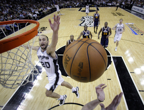 San Antonio Spurs' Manu Ginobili (20), of Argentina, reaches for a rebound during the first half of Game 1 of a first-round NBA basketball playoff series against the Utah Jazz, Sunday, April 29, 2012, in San Antonio.  San Antonio won 106-91. (AP Photo/Eric Gay)