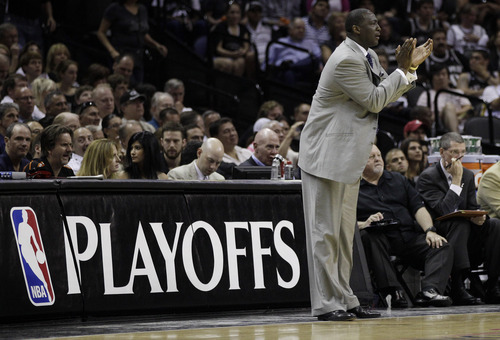 Utah Jazz head coach Tyrone Corbin talks to his players during the first quarter of Game 1 of a first-round NBA basketball playoff series against the San Antonio Spurs, Sunday, April 29, 2012, in San Antonio. San Antonio won 106-91. (AP Photo/Eric Gay)