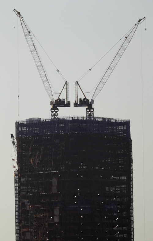 New York's One World Trade Center is viewed from Jersey City, N.J., Monday, April 30, 2012. One World Trade Center will lay claim to the title of New York City's tallest skyscraper on Monday when workers will erect steel columns that will make its unfinished skeleton a little over 1,250 feet high.(AP Photo/Julio Cortez)