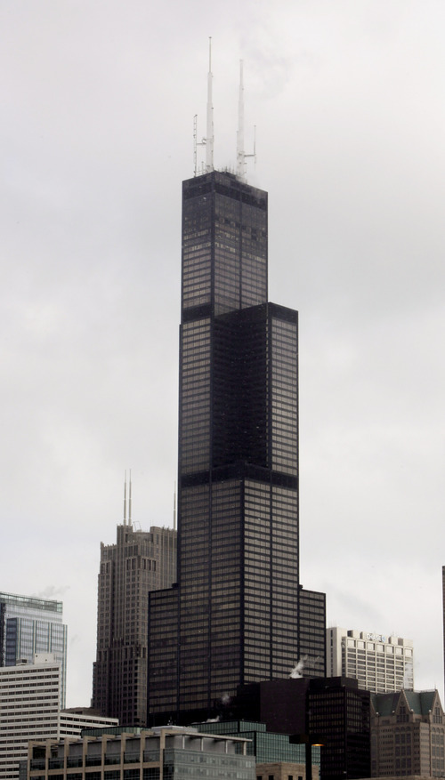 FILE- In this March 12, 2009, file photo, the Sears Tower, then the tallest building in America at 1,451 feet, rises above Chicago. One World Trade Center, the giant monolith being built to replace the twin towers destroyed in the Sept. 11 attacks, will lay claim to the title of New York City's tallest skyscraper on Monday, April 30, 2012, as workers erect steel columns that will make its unfinished skeleton a little over 1,250 feet, just high enough to peak over the observation deck on the Empire State Building.  Workers are still adding floors to the so-called