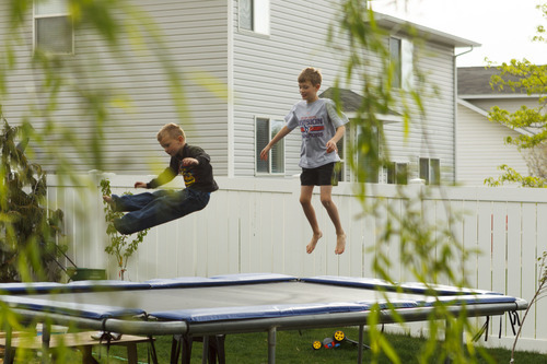 Trent Nelson  |  The Salt Lake Tribune Jack Wolfinger, right, jumps on a trampoline with his brother Dave Thursday in Ogden, Utah. After the CDC released new data on autism a few weeks ago, some experts are questioning the results. Jack was repeatedly labeled by teachers as possibly autistic, but last year a Utah psychologist said the symptoms were there but the diagnosis did not entirely fit.