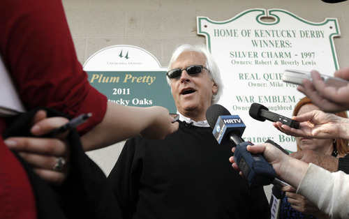 Charlie Riedel | The Associated Press Trainer Bob Baffert talks to the media after Kentucky Derby hopeful Liaison worked out at Churchill Downs in Louisville, Ky., Monday, April 30, 2012.  The Kentucky Derby horse race is scheduled for Saturday, May 5. (AP Photo/Charlie Riedel)