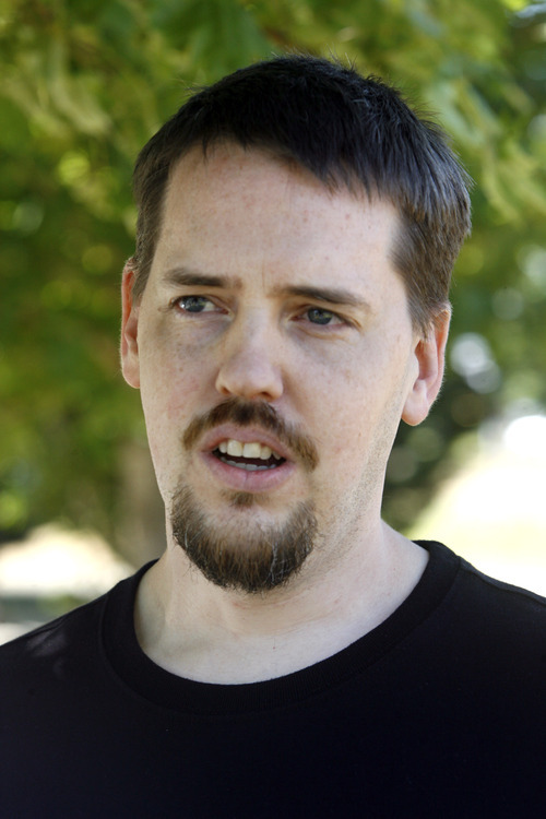 Rick Egan   |  Tribune file photo Joshua Powell talks in August 2011 in Puyallup, Wash., after his father, Steve Powell, was arrested and charged with 14 counts of voyeurism and possession of depictions of minors engaged in sexually explicit conduct.