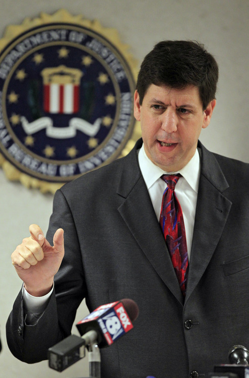U.S. Attorney Steven Dettelbach answers questions after announcing the arrest of five men for conspiring to blow up a bridge in Cleveland, Tuesday, May 1, 2012. A Justice department official says the five men are self-described anarchists and are not tied to international terrorism.   (AP Photo/Mark Duncan)