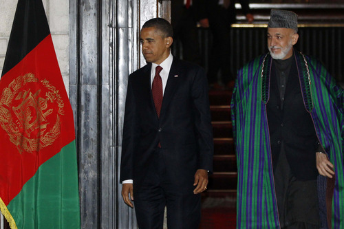 President Barack Obama and Afghan President Hamid Karzai arrive before signing a strategic partnership agreement, Tuesday, May 1, 2012, at the presidential palace in Kabul, Afghanistan. (AP Photo/Charles Dharapak)