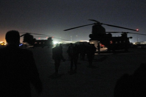Arriving in darkness, members of the press and the President Barack Obama's entourage walk from Air Force One to waiting helicopters at Bagram Air Field in Afghanistan, Tuesday, May 1, 2012. (AP Photo/Charles Dharapak)