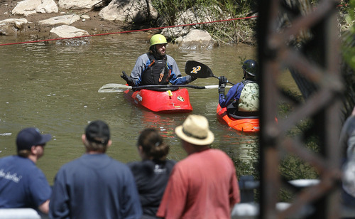 Scott Sommerdorf  |  The Salt Lake Tribune              Search and rescue personnel search for a missing 3-year-old boy in the Weber River just north of Exchange Road in Ogden, Sunday, April 29, 2012, while civilians - presumably family members - watch from a nearby bridge.